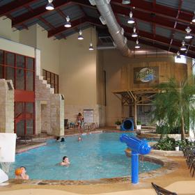 Indoor portion of the pool w/slide