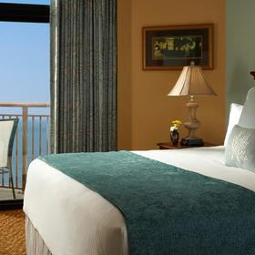 Hilton Grand Vacations Club (HGVC) at Anderson Ocean Club — Unit bedroom with balcony and ocean view