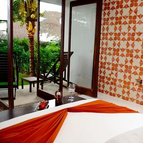 Le Reve Hotel & Spa — Bedroom and Balcony
