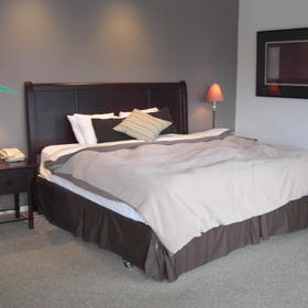 Large Master Bedroom with attached bath and access to deck and spa